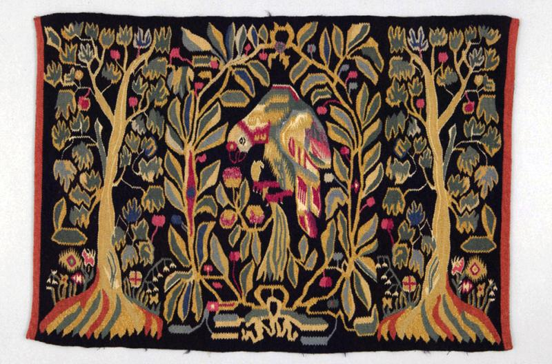 A traditional marriage pillow woven in traditional Scandinavian style depicting a colourful parrot and forest.