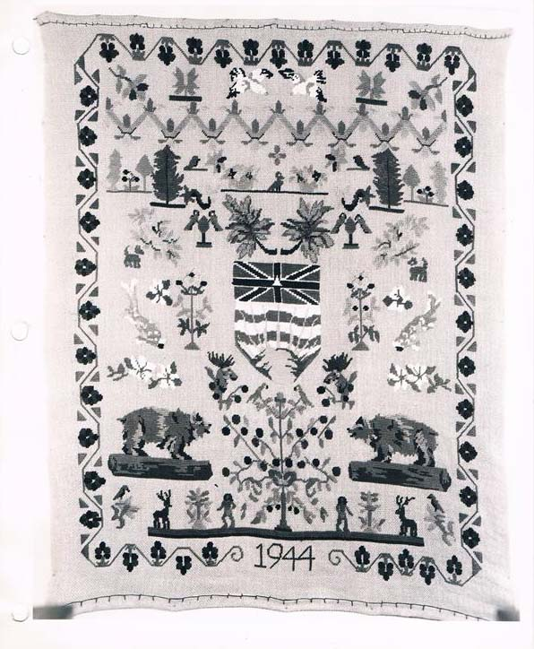 A woven sampler depicting animals and plants native to British Columbia, dated 1944 at bottom center.