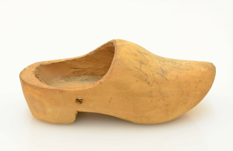 A lightly stained wooden clog in Dutch style, gifted to Harold Clement during liberation of Holland.