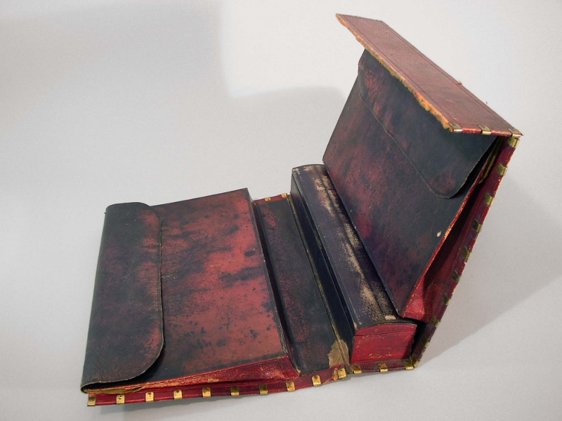 An open view of the dark red leather foldable dispatch case with polished brass trim, owned by Loyalist William Claus in 1812.