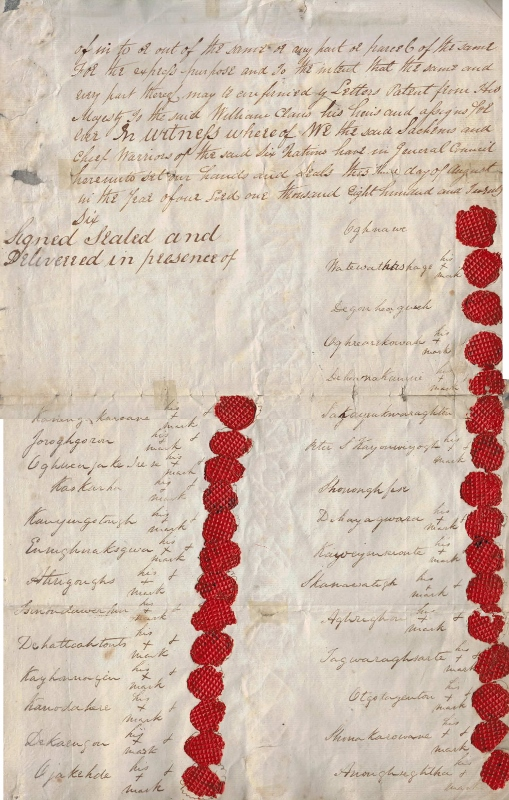 A handwritten document granting land to Daniel William Claus containing the names and seals of 54 First Nations Chiefs.