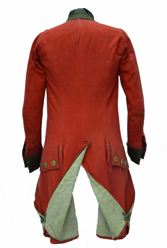 Rear view of the scarlet military coat with gold buttons and light grey inner lining, owned by Daniel Servos (1743–1808).