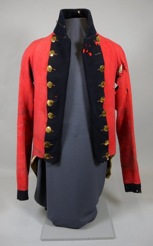Red military coat circa 1814 with blue navy trim and gold buttons, owned by Daniel McDougal.