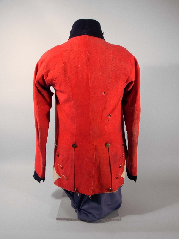 Rear view of red military coat circa 1814 with blue navy trim and gold buttons, owned by Daniel McDougal.