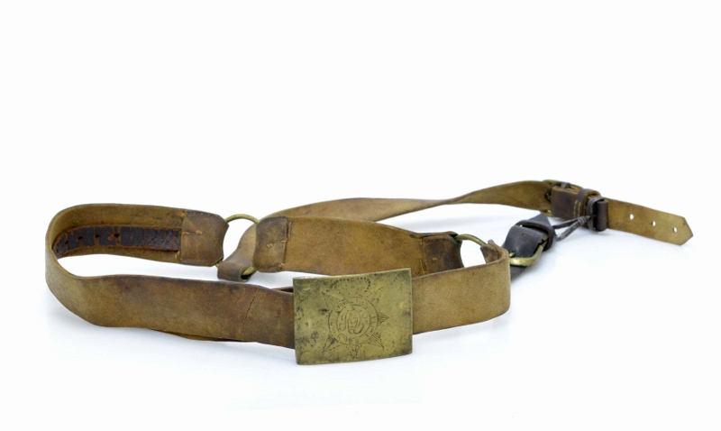 Aged brown belt and polished brass buckle of Sergeant-Major Adam Flanigan.