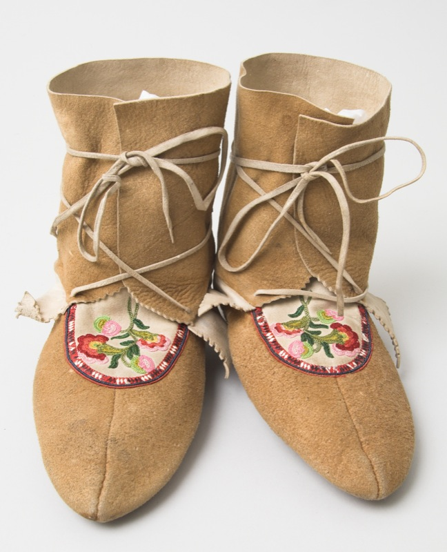 Adult moccasins made of tanned moose hide with floral silk embroidery, porcupine quill plaiting, and horsehair piping on the vamps.