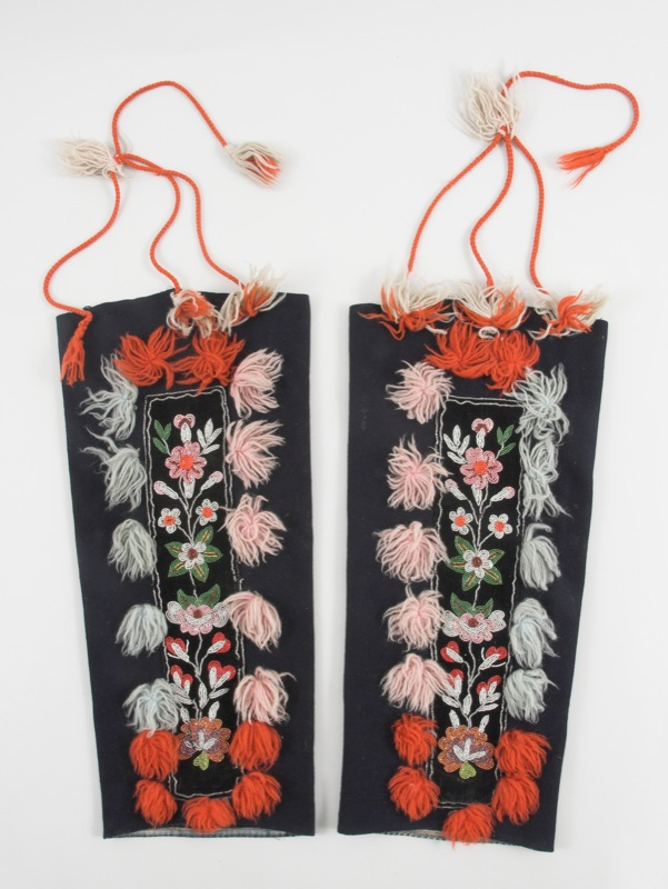 Black handmade leggings with velvet panels decorated with colourful glass beads and wool yarn tassels worn to keep snow out of mukluks.