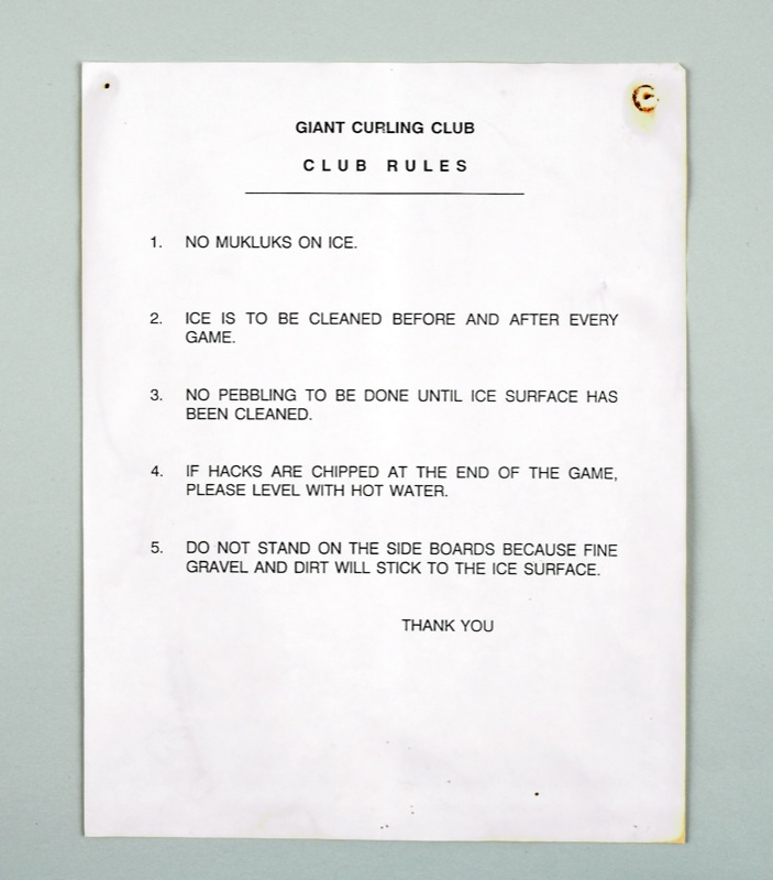 A stark white sign with listing 5 rules for the Giant Curling Club, including 'Rule 1. No Mukluks on ice.'