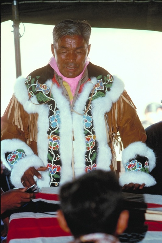 Chief Alexis Arrowmaker of Behchoko speaking publicly while wearing the vibrant beaded moose hide jacket.