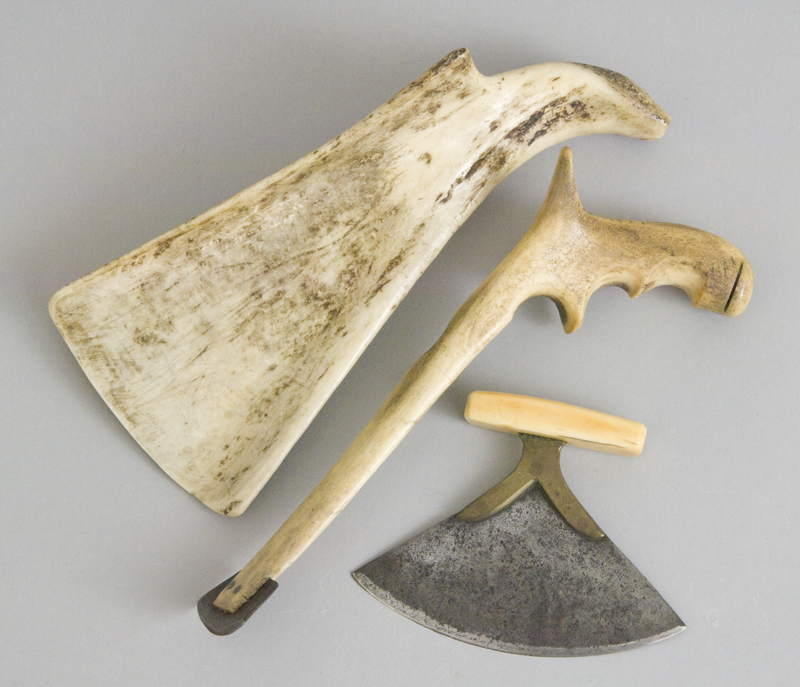 Three bladed tools made of bone, antler and metal used to scrape and cut caribou hides for clothing.