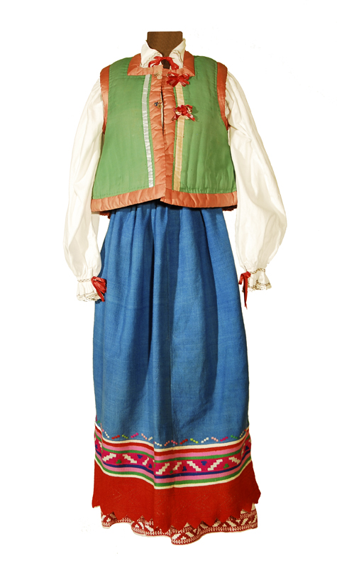 A colorful linen and cotton Doukhobor dress with rich reds, blues, and a green vest.