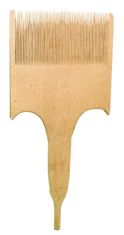 A pale brown handheld comb-like traditional Doukhobor flax carder.