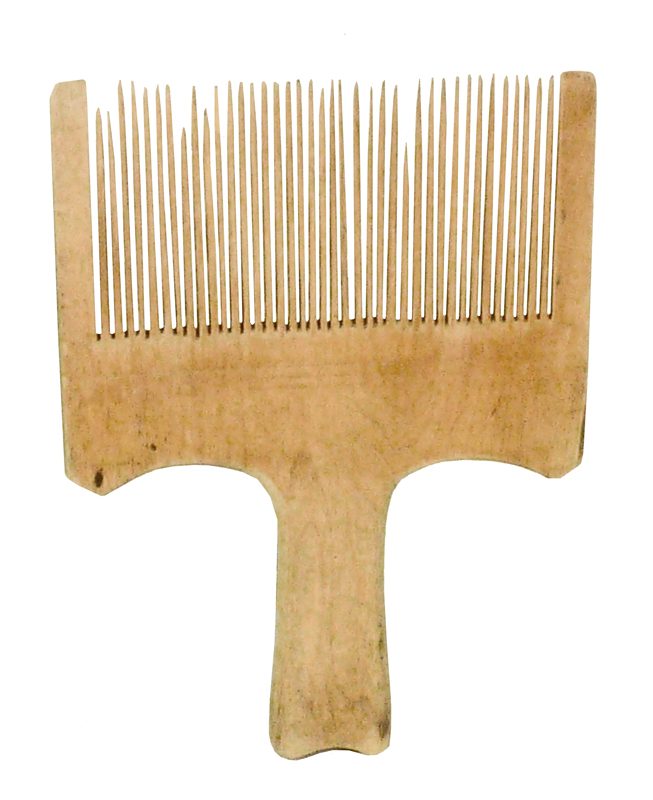 Another pale brown handheld comb-like traditional Doukhobor flax carder.