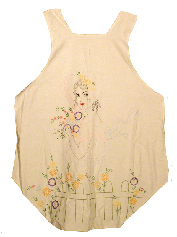 Apron made from sacking, showing a woman picking colourful flowers