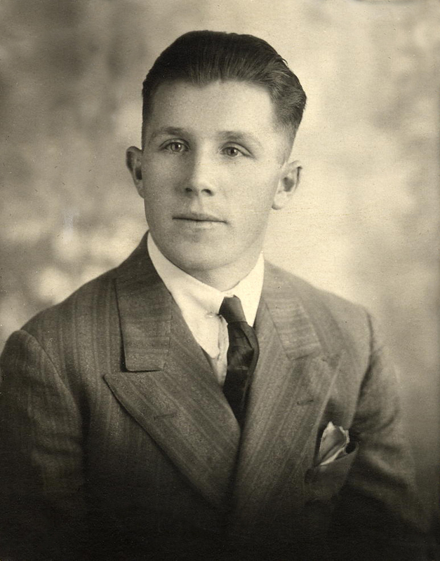 Professionally posed photograph of Ruddick Welwood in suit and tie, 1935.