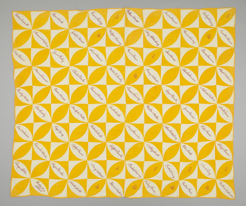 Alternating yellow and white squares containing pointed ovals of the opposing colour. The white ovals contain handsewn signatures in red thread.