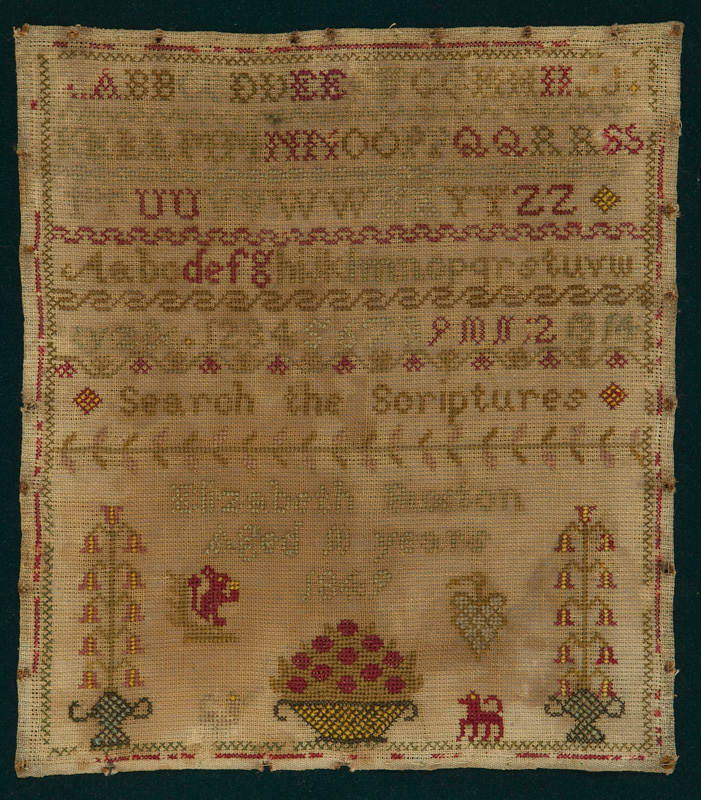 A sampler embroidered with a dog and a squirrel, the alphabet, numbers 1-14, the words 'search the scriptures' and the name and age of its maker.