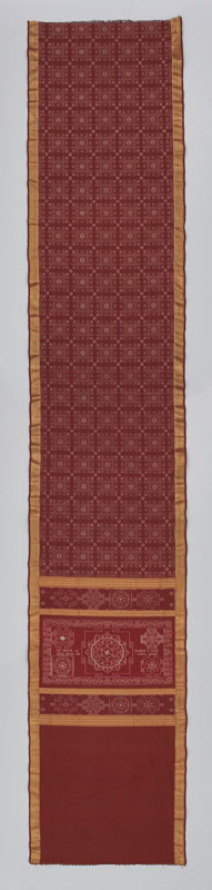 A rich burgundy sari woven with gold thread to create a bold border and geometric patterns.