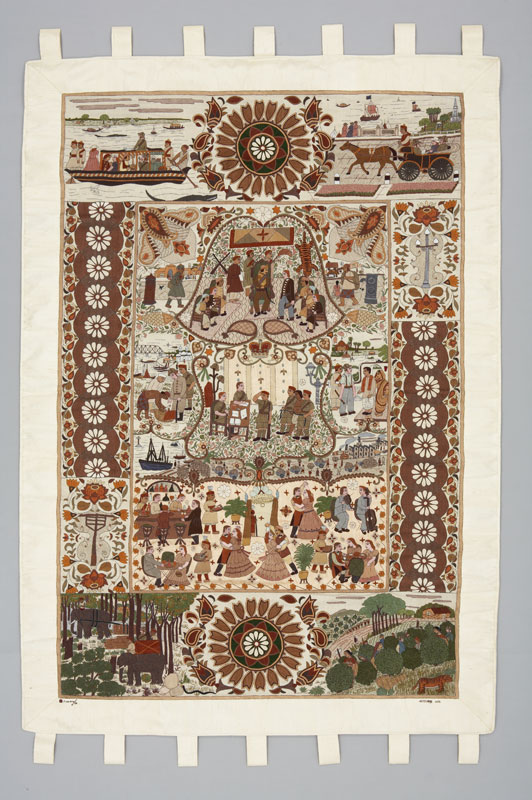 A large textile embroidery depicting scenes during the reign of George V (1910–1936) in India, highlighting relations between British officials and Indian community.