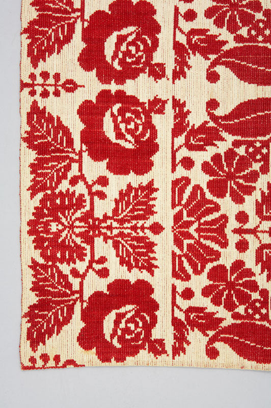 Detail of red and white rose border on this coverlet.