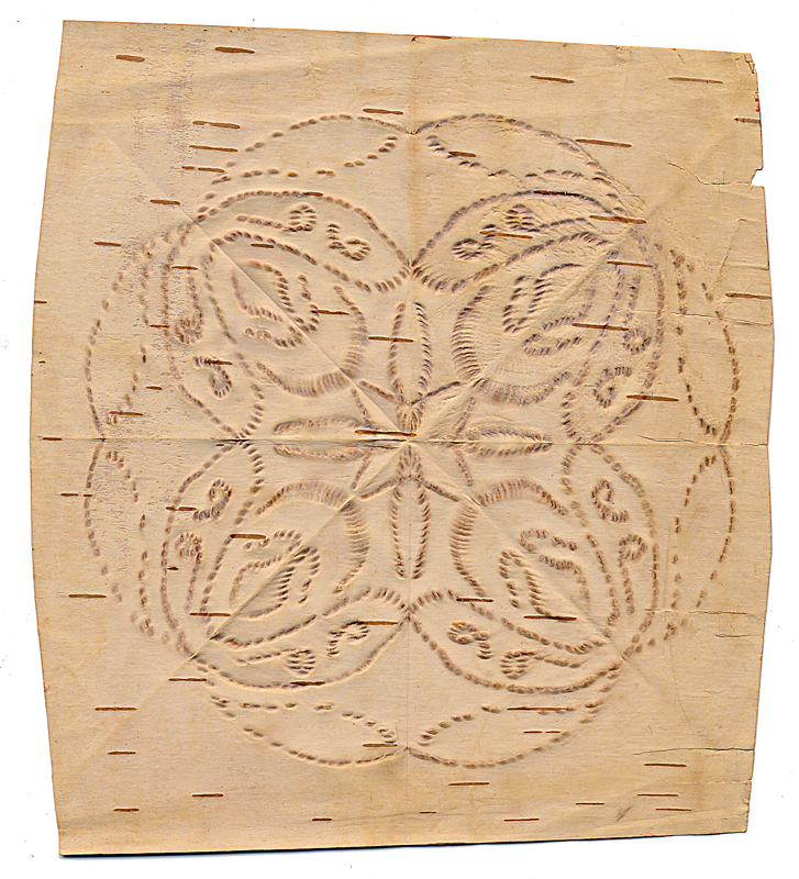A piece of birch bark with a bitten geometric design by artist Angelique Merasty.